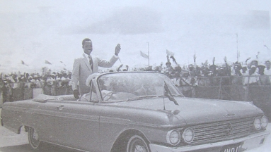 Nyerere waves to the crowd as he is driven around the Dar-es-Salaam stadium